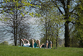 Young couple laying on the grass, Kensington Gardens, London.