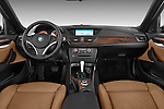 Straight dashboard view of a 2012 Bmw X1 xDrive20d 5 Door Suv 2WD