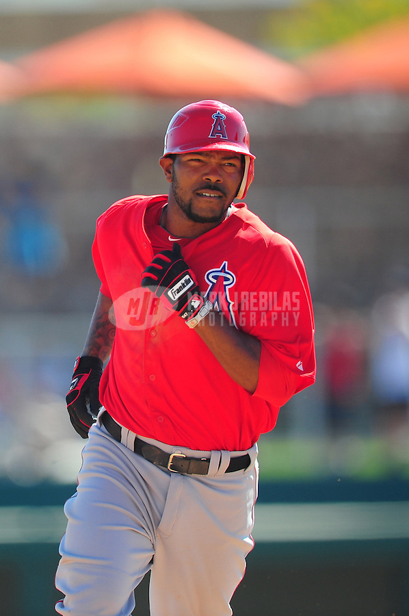 Mar. 14, 2012; Phoenix, AZ, USA; Anaheim Angels batter Howie Kendrick rounds the bases after hitting a solo home run in the fifth inning against the Chicago White Sox at The Ballpark at Camelback Ranch. Mandatory Credit: Mark J. Rebilas-