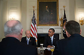 """United States President Barack Obama, right, speaks while meeting with members of the Democratic Governors Association in the State Dining Room of the White House with U.S. Vice President Joseph """"Joe"""" Biden, in Washington, D.C., U.S., on Friday, Feb. 21, 2014. Obama will emphasize Democratic priorities in his next budget, dropping an offer to trim the growth of entitlement spending and proposing new tax limits for U.S.-based multi-national companies. <br /> Credit: Andrew Harrer / Pool via CNP"""