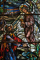 Stained glass window, 1523-41, detail, of the Agony in the Garden, depicting Jesus in the Garden of Olives with sleeping disciples and an angel holding a chalice, in the Catedral Nuestra Senora de la Encarnacion, or the Basilica Cathedral of Santa Maria la Menor, dedicated to St Mary of the Incarnation, built 1514-35 in Renaissance and Gothic style, in the Colonial Zone of Santo Domingo, capital of the Dominican Republic, in the Caribbean. The building is also known as the Catedral Primada de America as it is the oldest cathedral in the Americas. Santo Domingo's Colonial Zone is listed as a UNESCO World Heritage Site. Picture by Manuel Cohen