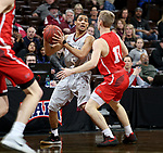 SIOUX FALLS, SD - MARCH 12:  Jacoby Claypool #5 from IU East looks for help while being guarded by Trevor Waite #13 from Indiana Wesleyan during their semifinal game at the 2018 NAIA DII Men's Basketball Championship at the Sanford Pentagon in Sioux Falls. (Photo by Dave Eggen/Inertia)