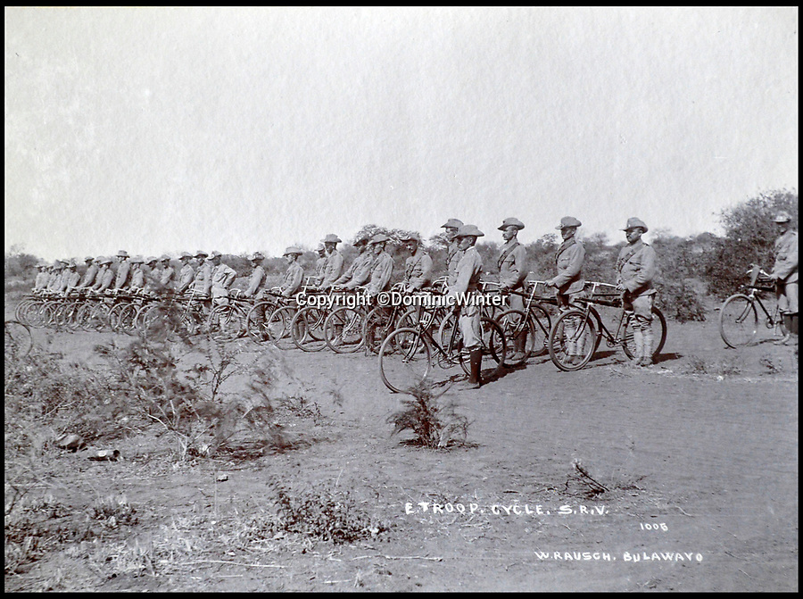 BNPS.co.uk (01202 558833)Pic: DominicWinter/BNPS<br /> <br /> Troops pose for photograph, Bulawayo. Rhodesia (Zimbabwe) 1896 and 1900.<br /> <br /> These fascinating photos capture life in southern Africa at the end of the 20th century at a time of great uncertainty for the region.<br /> <br /> They were taken between 1896 and 1900 and cover the period of the Second Matabele War in Rhodesia, today known as Zimbabwe.<br /> <br /> One photo shows soldiers at a lookout with ammunition around their necks poised and ready to fire.<br /> <br /> Another image is of a laager, an encampment protected by a circle of wagons or armored vehicles.<br /> <br /> There is also the remarkable sight of troops lined up on bicycles and an imposing fort in the hills.