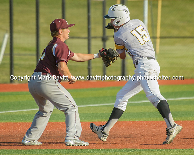Southeast Polk and Ankeny met for a double header at SEP June 21. SEP prevailed twice, 2-0 and 8-1. AHS's Drew Hill tags out SEP's Evan Martin.