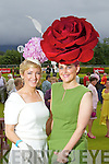 Queen of fashion runner up Elaine Kelliher, Kilgarvan and Joann Murphy, Kilgarvan, winner of best hat award at Killarney races ladies day on Thursday.