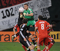 Toronto FC Goalkeeper Milos Kocic (30) goes up to defend the play.  Toronto FC. defeated DC United 3-2 at RFK Stadium, October 23, 2010.