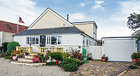 BNPS.co.uk (01202 558833)<br /> Pic: PurpleBricks/BNPS<br /> <br /> This £475,000 seaside cottage contains a charming secret – it's built around two Victorian railway carriages.<br /> <br /> The 19th century carriages were used as temporary housing for soldiers returning from the First World War when there was a shortage of homes.<br /> <br /> But many of them remained in place years later and had bricks and mortar built around them.<br /> <br /> And so from the street view they looked like normal houses but inside the main reception rooms were with the converted carriages.