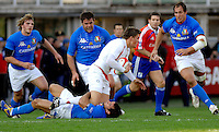 Photo: Omega/Richard Lane Photography. Italy v England. RBBS Six Nations. 10/02/2008. England's Toby Flood is tackled by the Italian defence.