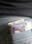 Roll of £20 notes in back pocket of denim jeans, UK