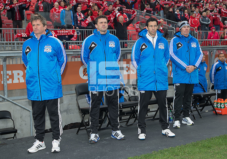 24 March 2012: The San Jose earthquakes coaching staff and team members stand for the national anthems during the opening ceremonies in a game between the San Jose Earthquakes and Toronto FC at BMO Field in Toronto..The San Jose Earthquakes won 3-0..