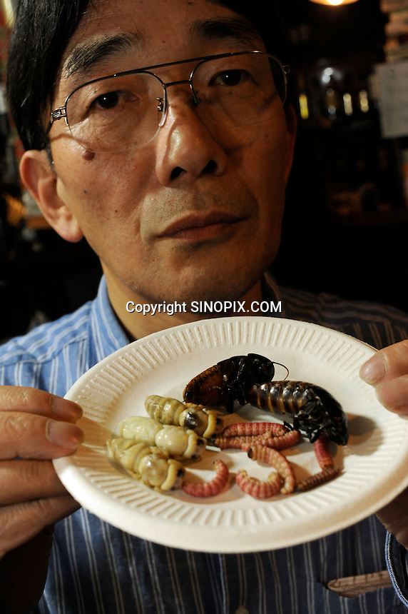Bug eating specialist Shoichi Uchiyama in Tokyo, Japan. The bug eating movement is gaining in popularity in Japan where bug eating gourmet cooking parties are sold-out.  The insects are seen as the ultimate challenge in the world's gastronomical capitol but alo seen as an important alternative source of protein for the future and even the Japanese Space Program is looking into using insects as food in space travel.