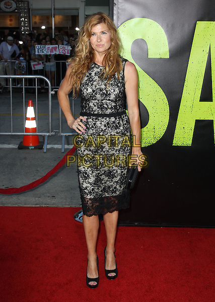 Connie Britton.The World Premiere of 'Savages' held at The Grauman's Chinese Theatre in Hollywood, California, USA..June 25th, 2012.full length black grey gray lace dress hand on hip sleeveless clutch bag.CAP/ADM/KB.©Kevan Brooks/AdMedia/Capital Pictures.