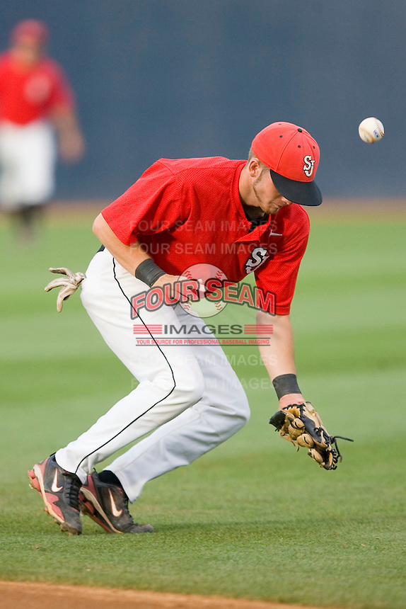 Second baseman Matt Wessinger #0 of the St. John's Red Storm can't handle a ground ball against the Virginia Cavaliers at the Charlottesville Regional of the 2010 College World Series at Davenport Field on June 6, 2010, in Charlottesville, Virginia.  The Red Storm defeated the Cavaliers 6-5.   Photo by Brian Westerholt / Four Seam Images