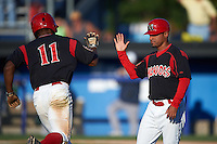 Batavia Muckdogs outfielder Stone Garrett (11) high fives manager Angel Espada (4) after hitting a home run during a game against the Vermont Lake Monsters August 9, 2015 at Dwyer Stadium in Batavia, New York.  Vermont defeated Batavia 11-5.  (Mike Janes/Four Seam Images)