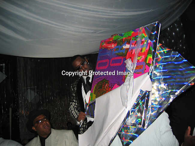 Sean P. Diddy Combs receives a gift from PM owner Unick, a painting of himself from Artist Jeffery Dread of Photovibe Gallery<br />**EXCLUSIVE**<br />Sean P. Diddy Combs Celebrates his 35th birthday by giving himself a Royal Birthday Ball &ndash; POST PARTY<br />PM Lounge<br />New York, NY, USA<br />Thursday, November 04, 2004<br />Photo By Celebrityvibe.com/Photovibe.com, New York, USA, Phone 212 410 5354, email:sales@celebrityvibe.com