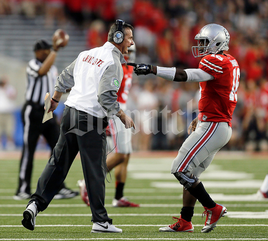 Ohio State Buckeyes head coach Urban Meyer yells at Ohio State Buckeyes quarterback J.T. Barrett (16) during the second quarter of Saturday's NCAA Division I football game at Ohio Stadium in Columbus on September 27, 2014. (Columbus Dispatch photo by Jonathan Quilter)