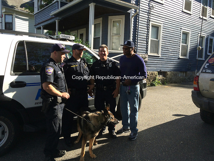 TORRINGTON, CT- 06 June 2015- 060615BJ01-- Torrington police officers Jason Cooling, Sgt. Kevin Sultaire and James Delay talk with Jacque Williams at a police appreciation party held by Rickie Flowers and Keyana Perry at 265 Riverside Ave., Torrington. Bruno Matarazzo Jr. Republican-American
