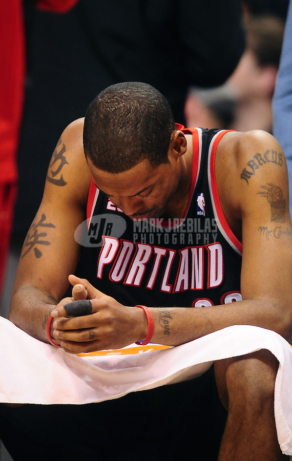 Jan. 14, 2011; Phoenix, AZ, USA; Portland Trailblazers center (23) Marcus Camby reacts on the bench against the Phoenix Suns at the US Airways Center. The Suns defeated the Trailblazers 115-111. Mandatory Credit: Mark J. Rebilas-