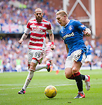 Martyn Waghorn clutches his hamstring and falls to the ground in pain