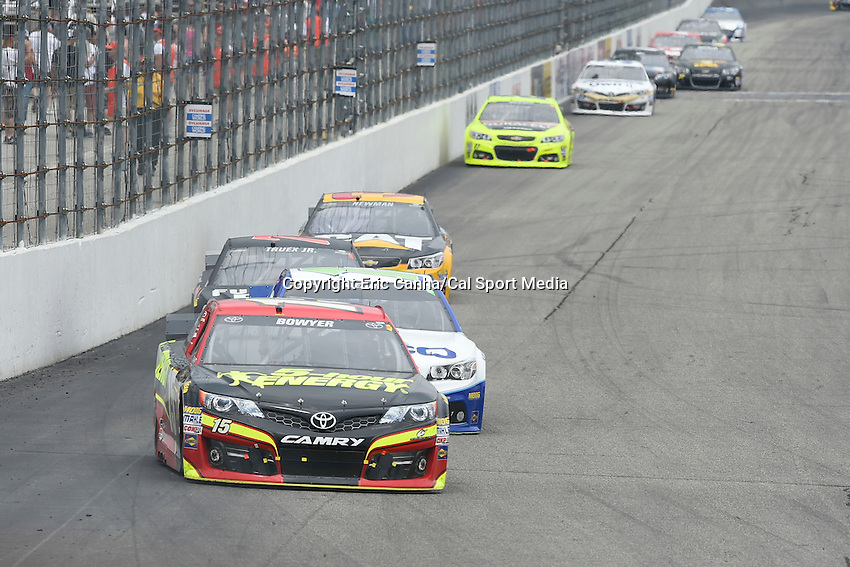July 13, 2014 - Loudon, New Hampshire, U.S. - Sprint Cup Series driver Clint Bowyer (15) comes out of the front straight away at  the NASCAR Sprint Cup Series Camping World RV 301 race held at the New Hampshire Motor Speedway in Loudon, New Hampshire. Eric Canha/CSM