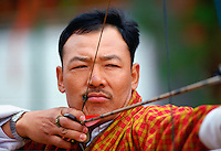 Archer taking aim during archery festival, Paro, Bhutan