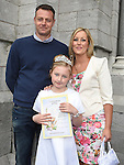 Abi Collier Stroebel from St Oliver's school who received her first holy communion at St Peters chuch pictured with parents Adre and Michelle. Photo:Colin Bell/pressphotos.ie