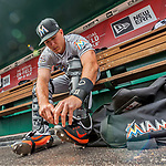 3 April 2017: Miami Marlins catcher J.T. Realmuto dons his gear in the dugout prior to Opening Day against the Washington Nationals at Nationals Park in Washington, DC. The Nationals defeated the Marlins 4-2 to open the 2017 MLB Season. Mandatory Credit: Ed Wolfstein Photo *** RAW (NEF) Image File Available ***