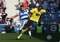 Blackburn Rovers' Amari'i Bell is challenged by Queens Park Rangers' Nahki Wells<br /> <br /> Photographer Rob Newell/CameraSport<br /> <br /> The EFL Sky Bet Championship - Queens Park Rangers v Blackburn Rovers - Friday 19th April 2019 - Loftus Road - London<br /> <br /> World Copyright © 2019 CameraSport. All rights reserved. 43 Linden Ave. Countesthorpe. Leicester. England. LE8 5PG - Tel: +44 (0) 116 277 4147 - admin@camerasport.com - www.camerasport.com