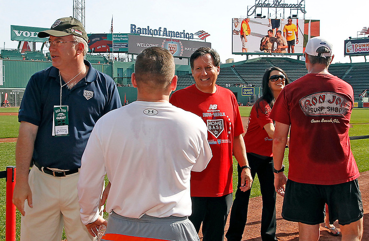 BOSTON -- From left, Dr. Peter Slavin, president of Massachusetts General Hospital, Boston Red Sox chairman Tom Werner and Linda Pizzuti Henry, wife of Red Sox principal owner John Henry thank runners following the Run-Walk to Home Base Presented by New Balance at Fenway Park, a charity event benefitting the Red Sox Foundation and Massachusetts General Hospital Home Base Program on Sunday, May 20, 2012. (Brita Meng Outzen/Boston Red Sox)