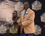 Canton, Ohio - August 8, 2015: Former NFL player Charles Haley poses with his bust during the 2015 Pro Football Hall of Fame enshrinement in Canton, Ohio, August 8, 2015. At the time of his induction, Haley is the  only player in NFL history to have played on five winning Super Bowl teams. (Photo by Don Baxter/Media Images International)