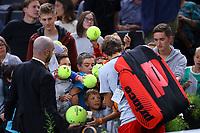 1st November 2019, AccorHotels Arena, Bercy, Paris, France; Rolex Paris Masters tennis tournament;  Lucas Pouille (FRA) signs autographs for the kids