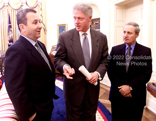 Washington, D.C. - December 16, 1999 -- United States President Bill Clinton meets with Prime Minister Ehud Barak of Israel and Foreign Minister Farouk al-Sharaa of Syria in The Oval Office, The White House December 16, 1999 -- From Left to Right:  Prime Minister Barak; THE PRESIDENT;  Foreign Minister al-Shara..Credit: Sharon Farmer - White House via CNP