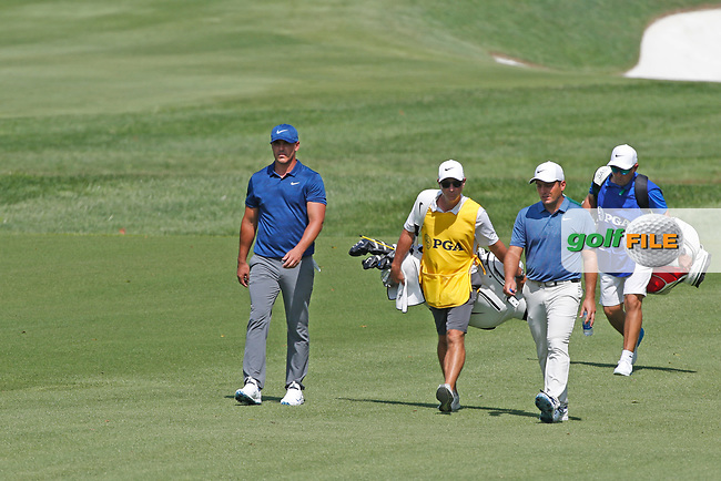 Brooks Koepka (USA) and Francesco Molinari (ITA) walks the 9th hole during the first round of the 100th PGA Championship at Bellerive Country Club, St. Louis, Missouri, USA. 8/9/2018.<br /> Picture: Golffile.ie | Brian Spurlock<br /> <br /> All photo usage must carry mandatory copyright credit (© Golffile | Brian Spurlock)