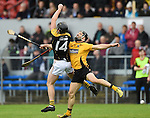 Eoghan Donnellan of Ballyea in action against Domhnall O Donovan of Clonlara during the senior hurling county final at Cusack park. Photograph by John Kelly.