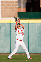 Adam Melker (26) of the Springfield Cardinals catches a fly ball to right field during a game against the St. Louis Cardinals at Hammons Field on April 2, 2012 in Springfield, Missouri. (David Welker/Four Seam Images)
