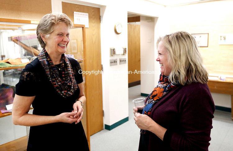Woodbury, CT- 17 November 2016-111716CM06- Sue Piel, left, shares a laugh with Marla Martin, teen librarian during a reception at the the Woodbury Public Library on Thursday. Piel who has worked there for more than 20 years, has been named the new director at the library.     Christopher Massa Republican-American
