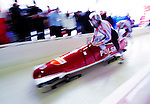 18 December 2010: Dawid Kupczyk pushes his 2-man bobsled for Poland, finishing in 14th place at the Viessmann FIBT World Cup Bobsled Championships on Mount Van Hoevenberg in Lake Placid, New York, USA. Mandatory Credit: Ed Wolfstein Photo