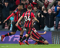 Jordon Ibe of AFC Bournemouth knees slides to celebrate his goal with Lys Mousset & Ryan Fraser of AFC Bournemouth during the Premier League match between Bournemouth and Arsenal at the Goldsands Stadium, Bournemouth, England on 14 January 2018. Photo by Andy Rowland.