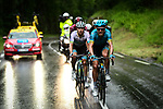 The heavens open on Magnus Cort Nielsen (DEN) and lexey Lutsenko (KAZ) Astana during Stage 7 of the Criterium du Dauphine 2019, running 133.5km from Saint-Genix-les-Villages to Les Sept Laux - Pipay, France. 15th June 2019.<br /> Picture: ASO/Alex Broadway | Cyclefile<br /> All photos usage must carry mandatory copyright credit (© Cyclefile | ASO/Alex Broadway)
