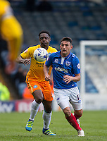 Gary Roberts of Portsmouth & Anthony Stewart of Wycombe Wanderers in action during the Sky Bet League 2 match between Portsmouth and Wycombe Wanderers at Fratton Park, Portsmouth, England on 23 April 2016. Photo by Andy Rowland.