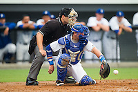 Chase Vallot (8) of the Burlington Royals catches a low pitch as home plate umpire Garon Keuten looks on during the game against the Elizabethton Twins at Burlington Athletic Park on June 25, 2014 in Burlington, North Carolina.  The Twins defeated the Royals 8-0. (Brian Westerholt/Four Seam Images)