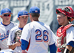 Reno coach Pete Savage (26) talks to pitcher Christian Chamberlain in the NIAA Division I Northern Region Baseball Championship between the Galena Grizzlies and the Reno Huskies played on Saturday, May 14, 2016 at Peccole Park in Reno, Nevada.