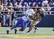 Annapolis, MD - October 7, 2017: Navy Midshipmen quarterback Zach Abey (9) gets tackled by several Air Force Falcons defenders during the game between Air Force and Navy at  Navy-Marine Corps Memorial Stadium in Annapolis, MD.   (Photo by Elliott Brown/Media Images International)