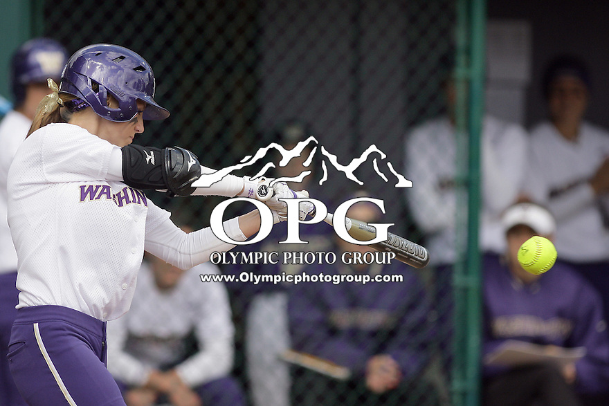 23 May 2010:  Washington Huskies right fielder #4 Kim Pohlman takes a swing at an University of North Carolina pitch.  Washington defeated the University of North Carolina 2-1 in eight innings at Husky Softball Stadium in Seattle, WA to advance in the NCAA regional tournament.