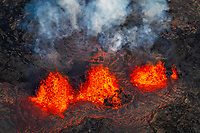 aerial view of lava eruption along linear fissure vents, fountaining several hundred feet into the air, Leilani Estates, Kilauea, Big Island, Hawaii, USA