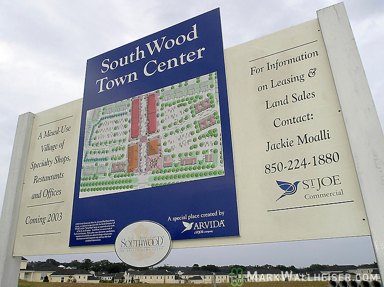 """Coming 2003"" sign at the intersection of Marchant's Row and Four Oaks Blvd announcing more growth at the St Joe development Southwood Plantation in Tallahassee, Florida."