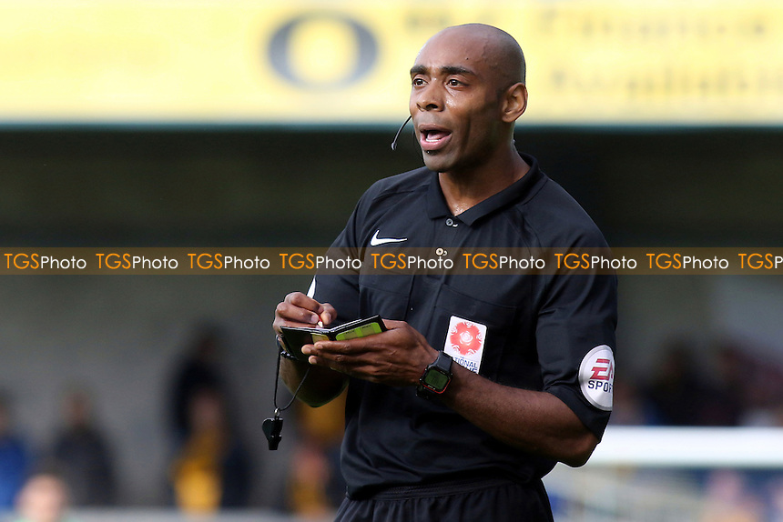 Referee Samuel Allison, takes down the name of Maidstone's Jack Paxman prior to showing him a yellow card during Torquay United vs Maidstone United , Vanarama National League Football at Plainmoor on 24th September 2016