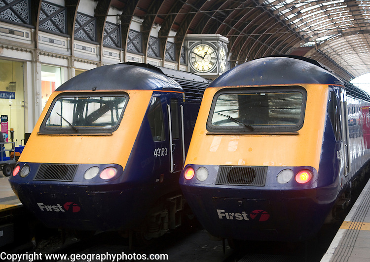Two First diesel locomotive trains, Paddington railway station, London, England