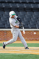 Eric Escobedo (12) of the Marshall Thundering Herd makes contact with the baseball against the Wake Forest Demon Deacons at Wake Forest Baseball Park on February 17, 2014 in Winston-Salem, North Carolina.  The Demon Deacons defeated the Thundering Herd 4-3.  (Brian Westerholt/Four Seam Images)