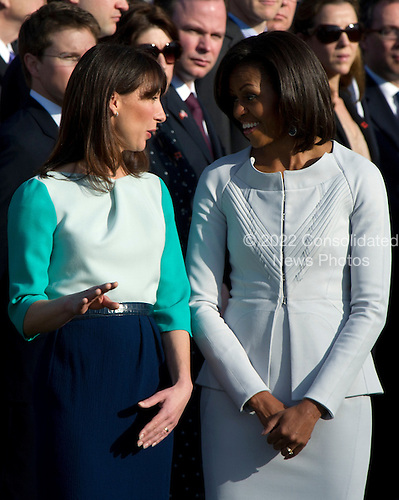 First lady Michelle Obama and Samantha Cameron share some thoughts during the ceremony to welcome Mrs. Cameron and her husband, Prime Minister David Cameron of Great Britain to the White House in Washington, D.C. on Wednesday, March 14, 2012..Credit: Ron Sachs / CNP
